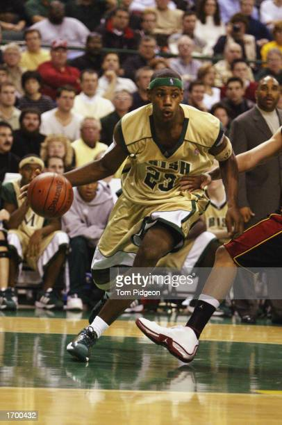 LeBron James of St VincentSt Mary High School drives against Oak Hill Academy at the Cleveland State University Convocation Center on December 12...
