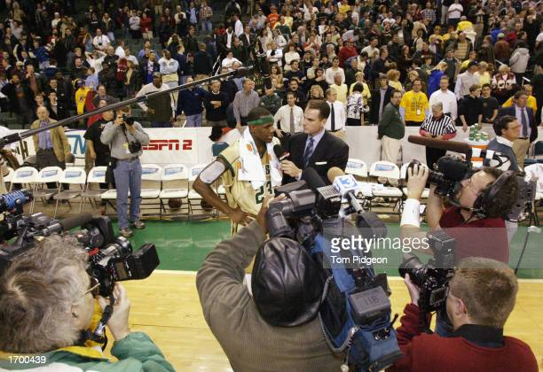 LeBron James of St VincentSt Mary High School is interviewed by ESPN after the game against Oak Hill Academy as other television cameras record the...