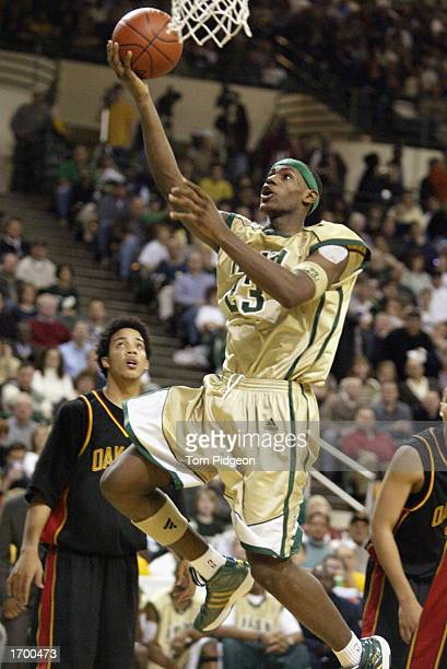 LeBron James of St VincentSt Mary High School shoots a layup against Oak Hill Academy at the Cleveland State University Convocation Center on...