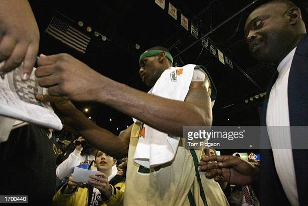 LeBron James of St VincentSt Mary High School signs autographs after the game against Oak Hill Academy at the Cleveland State University Convocation...