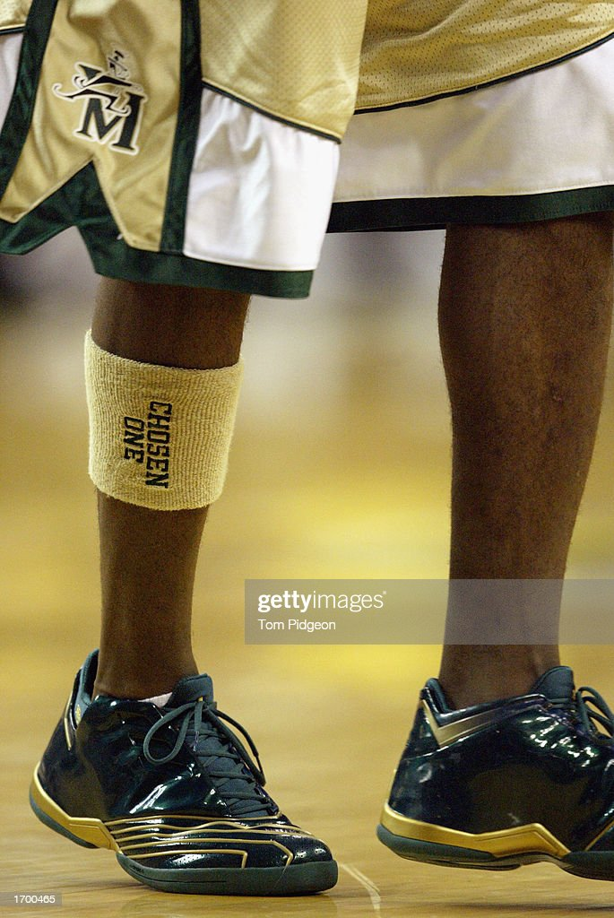 LeBron James #23 of St. Vincent-St. Mary High School wears a sweatband on his leg that reads, 'Chosen One' during the game against Oak Hill Academy at the Cleveland State University Convocation Center on December 12, 2002 in Cleveland, Ohio. James scored 31 points in leading St. Vincent-St. Mary to a 65-45 upset over Oak Hill Academy, the nation's number one ranked high school team.