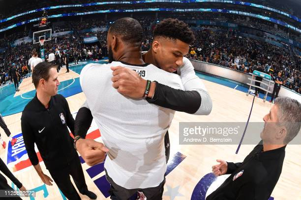 LeBron James of Team LeBron and Giannis Antetokounmpo of Team Giannis hug before the 2019 NBA AllStar Game on February 17 2019 at the Spectrum Center...