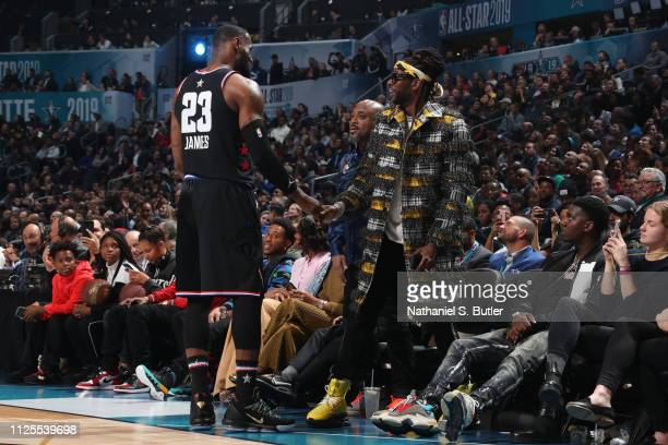 LeBron James of Team LeBron and Rapper 2 Chainz shake hands during the 2019 NBA AllStar Game on February 17 2019 at the Spectrum Center in Charlotte...