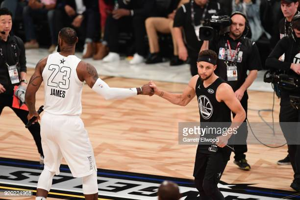 LeBron James of Team LeBron and Stephen Curry of Team Stephen before the NBA AllStar Game as a part of 2018 NBA AllStar Weekend at STAPLES Center on...