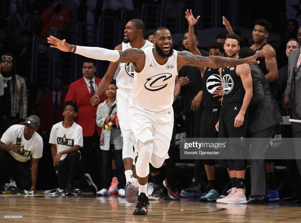 LeBron James #23 of Team LeBron celebrates as Stephen Curry #30 of Team Stephen looks on after the end of the NBA All-Star Game 2018 at Staples Center on February 18, 2018 in Los Angeles, California.