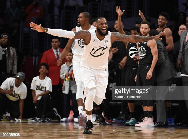 LeBron James of Team LeBron celebrates as Stephen Curry of Team Stephen looks on after the end of the NBA AllStar Game 2018 at Staples Center on...