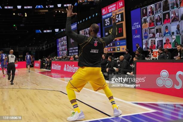 LeBron James of Team LeBron celebrates on the court during the 70th NBA All Star Game as part of 2021 NBA All Star Weekend on March 7, 2021 at State...