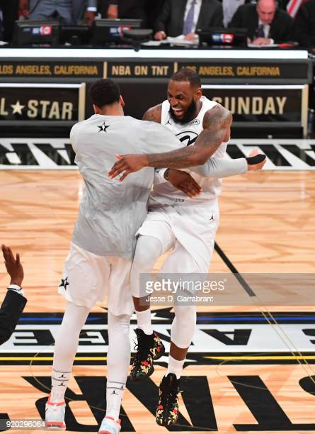 LeBron James of Team LeBron chest bumps Anthony Davis after winning against Team Curry during the NBA AllStar Game as a part of 2018 NBA AllStar...