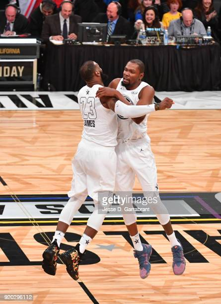 LeBron James of Team LeBron chest bumps Kevin Durant after winning against Team Curry during the NBA AllStar Game as a part of 2018 NBA AllStar...