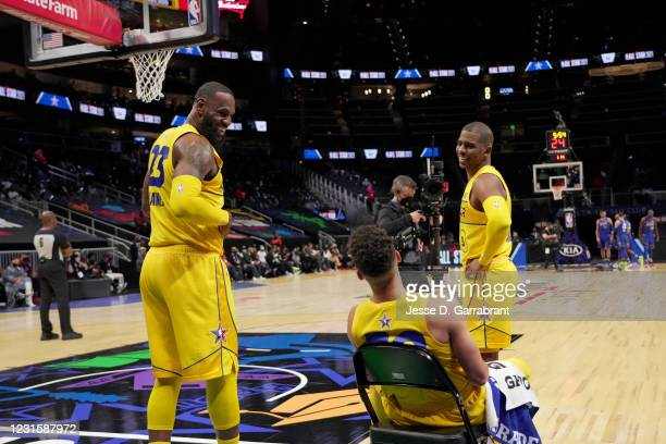 LeBron James of Team LeBron, Chris Paul of Team LeBron, and Stephen Curry of Team LeBron talk during the 70th NBA All Star Game as part of 2021 NBA...