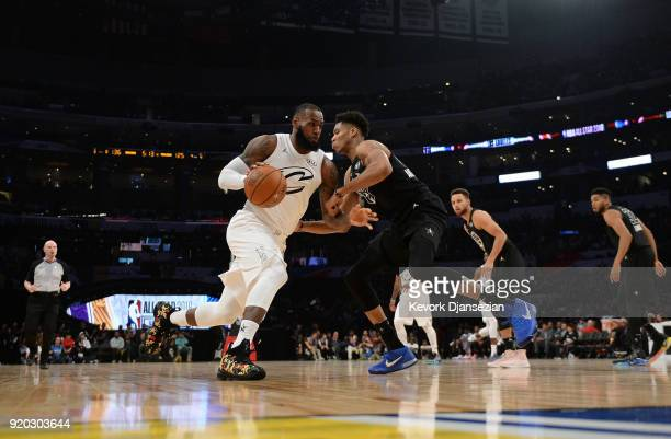 LeBron James of Team LeBron drives into Giannis Antetokounmpo of Team Stephen during the NBA AllStar Game 2018 at Staples Center on February 18 2018...