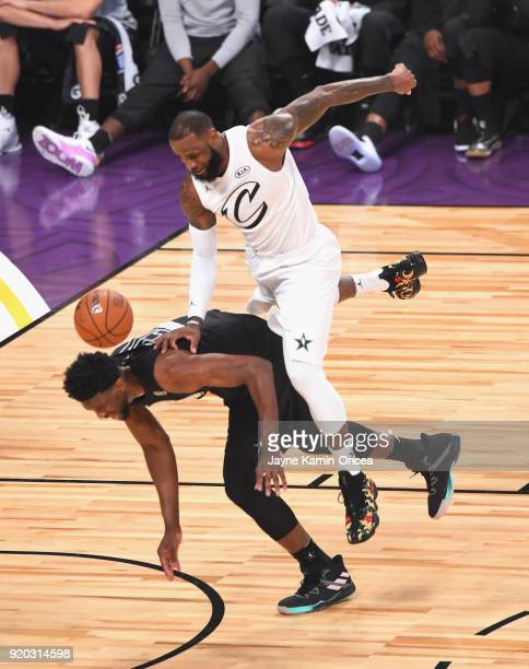 LeBron James of Team LeBron falls on Joel EmBiid of Team Stephen during the NBA AllStar Game 2018 at Staples Center on February 18 2018 in Los...