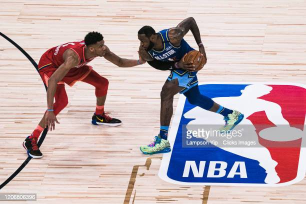 LeBron James of Team LeBron handles the ball against Giannis Antetokounmpo of Team Giannis during the 69th NBA All-Star Game on February 16, 2020 at...