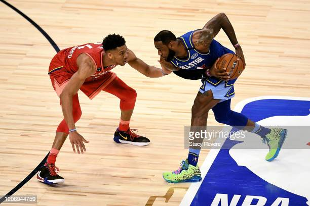 LeBron James of Team LeBron handles the ball while being guarded by Giannis Antetokounmpo of Team Giannis in the fourth quarter during the 69th NBA...