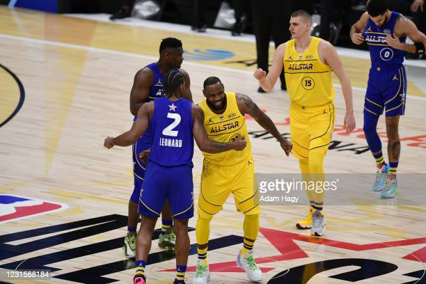 LeBron James of Team LeBron hi-fives Kawhi Leonard of Team Durant during the 70th NBA All Star Game as part of 2021 NBA All Star Weekend on March 7,...