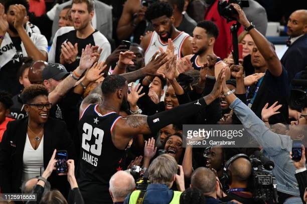 LeBron James of Team LeBron high fives fans during the 2019 NBA All Star Game against Team Giannis on February 17 2019 at Spectrum Center in...