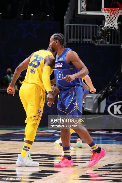 LeBron James of Team LeBron high fives Kawhi Leonard of Team Durant during the 70th NBA All Star Game as part of 2021 NBA All Star Weekend on March...