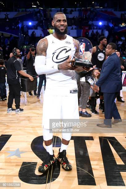 LeBron James of Team LeBron is presented the MVP trophy for the NBA AllStar Game as a part of 2018 NBA AllStar Weekend at STAPLES Center on February...