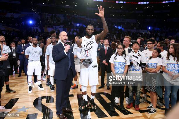 LeBron James of Team LeBron is presented the MVP trophy for the NBA AllStar Game by Ernie Johnson Jr as a part of 2018 NBA AllStar Weekend at STAPLES...