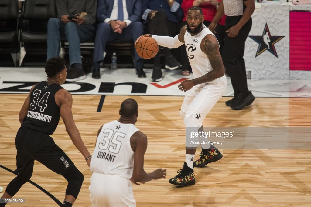 LeBron James #23 of Team Lebron looks to pass the ball to teammate Kevin Durant #35 during the 2018 NBA All-Star Game at the Staples Center in Los Angeles, California on February 18, 2018.