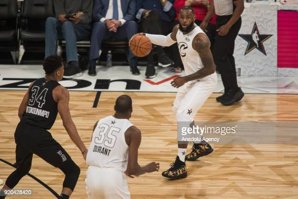 LeBron James of Team Lebron looks to pass the ball to teammate Kevin Durant during the 2018 NBA AllStar Game at the Staples Center in Los Angeles...