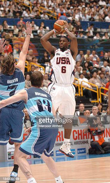 LeBron James of Team USA shoots a jumper as Fabricio Oberto of Argentina tries to block during the Bronze Medal game at the FIBA World Championship...