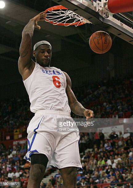 LeBron James of Team White dunks during the US Fleet Tracking Basketball Invitational charity basketball game October 23 2011 at the Cox Convention...