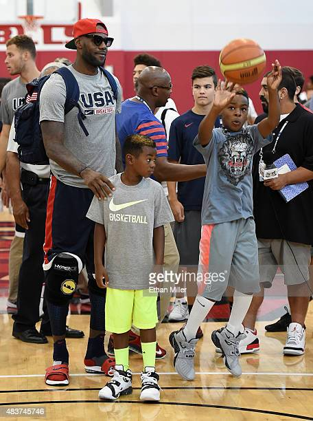 LeBron James of the 2015 USA Basketball Men's National Team and his sons Bryce James and LeBron James Jr attend a practice session at the Mendenhall...