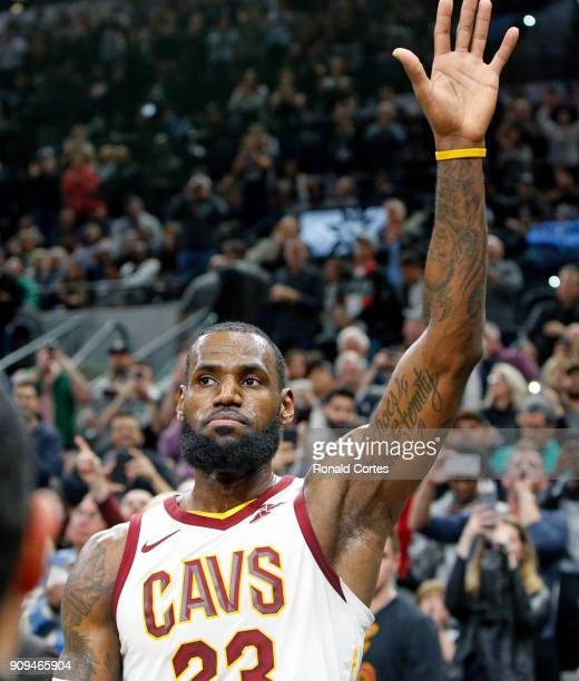 LeBron James of the Cleveland Cavaliers acknowledges the crowd after hitting his 30001 point during game against the San Antonio Spurs at ATT Center...