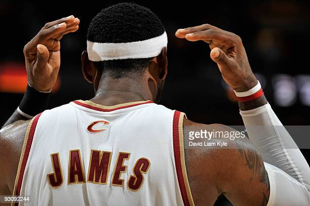 LeBron James of the Cleveland Cavaliers adjusts his headband during the game against the Chicago Bulls on November 5, 2009 at Quicken Loans Arena in...