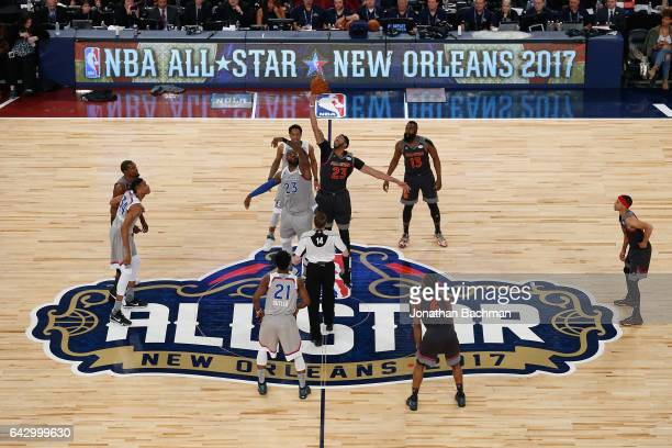 LeBron James of the Cleveland Cavaliers and Anthony Davis of the New Orleans Pelicans battle for the opening tipoff at the start of the 2017 NBA...