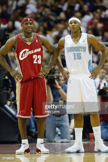 LeBron James of the Cleveland Cavaliers and Carmelo Anthony of the Denver Nuggets look on during the game on November 5 2003 at Gund Arena in...