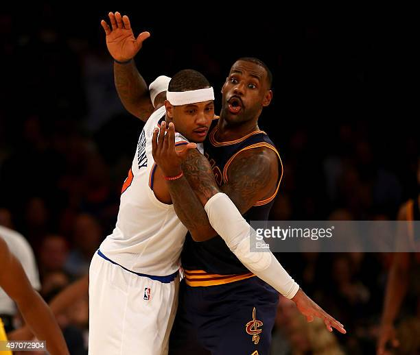 LeBron James of the Cleveland Cavaliers and Carmelo Anthony of the New York Knicks fight for position in the final minutes of the game at Madison...