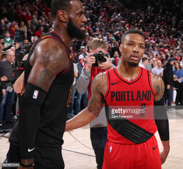 LeBron James of the Cleveland Cavaliers and Damian Lillard of the Portland Trail Blazers greet each other coming off the court after the game on...