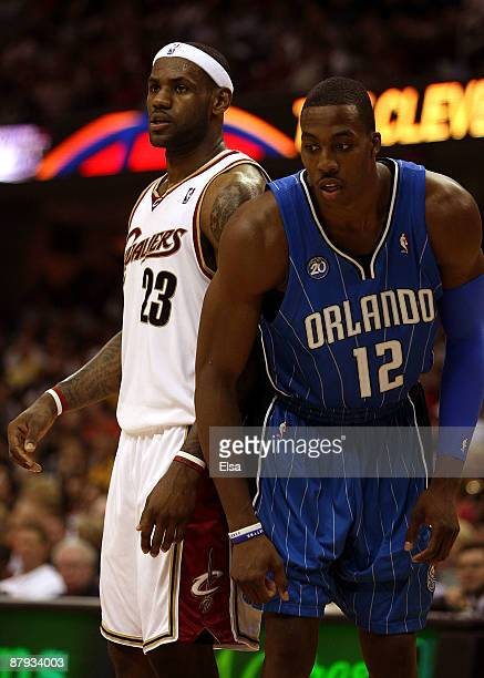 LeBron James of the Cleveland Cavaliers and Dwight Howard of the Orlando Magic get in position for a free throw in Game Two of the Eastern Conference...