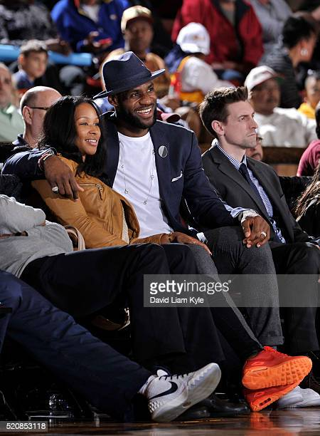 LeBron James of the Cleveland Cavaliers and his wife Savannah Brinson enjoy the game between the Canton Charge and the Sioux Falls Skyforce at the...
