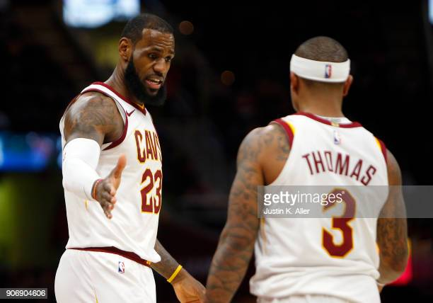 LeBron James of the Cleveland Cavaliers and Isaiah Thomas of the Cleveland Cavaliers react to a foul against the Orlando Magic at Quicken Loans Arena...