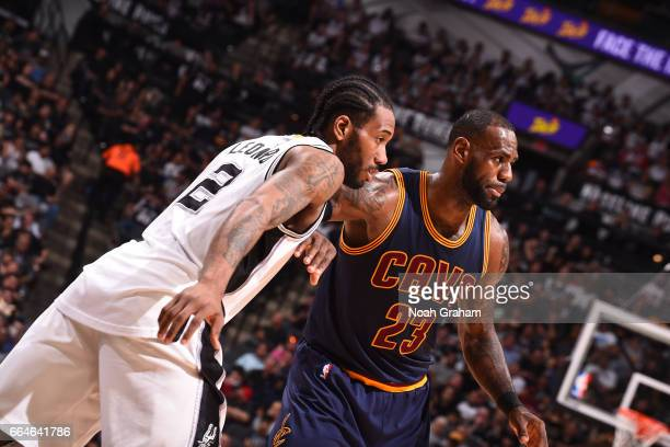 LeBron James of the Cleveland Cavaliers and Kawhi Leonard of the San Antonio Spurs fight for position during a game on March 27 2017 at the ATT...