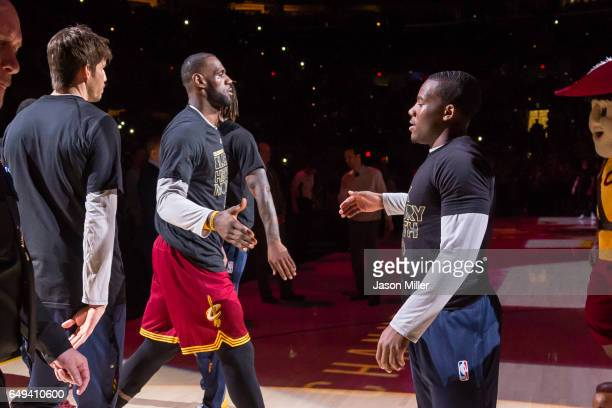 LeBron James of the Cleveland Cavaliers and Kay Felder during the player introduction prior to the game against the New York Knicks at Quicken Loans...