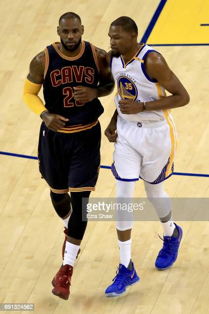 LeBron James of the Cleveland Cavaliers and Kevin Durant of the Golden State Warriors jog on the court in Game 1 of the 2017 NBA Finals at ORACLE...