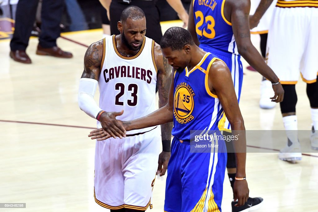 LeBron James #23 of the Cleveland Cavaliers and Kevin Durant #35 of the Golden State Warriors react in the third quarter in Game 4 of the 2017 NBA Finals at Quicken Loans Arena on June 9, 2017 in Cleveland, Ohio.