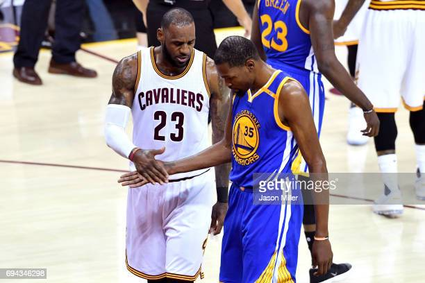 LeBron James of the Cleveland Cavaliers and Kevin Durant of the Golden State Warriors react in the third quarter in Game 4 of the 2017 NBA Finals at...
