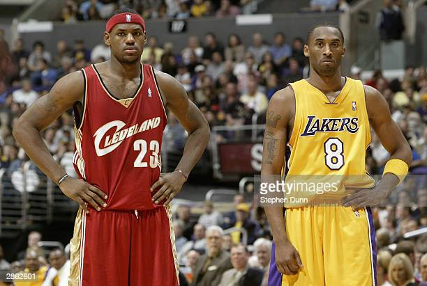 LeBron James of the Cleveland Cavaliers and Kobe Bryant of the Los Angeles Lakers look on January 12 2004 at Staples Center in Los Angeles California...