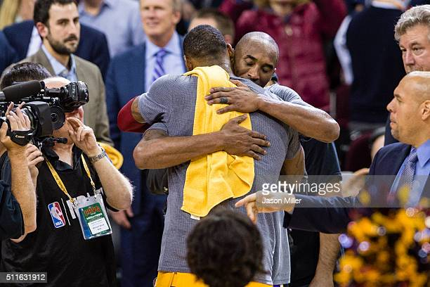 LeBron James of the Cleveland Cavaliers and Kobe Bryant of the Los Angeles Lakers hug after the game at Quicken Loans Arena on February 10 2016 in...