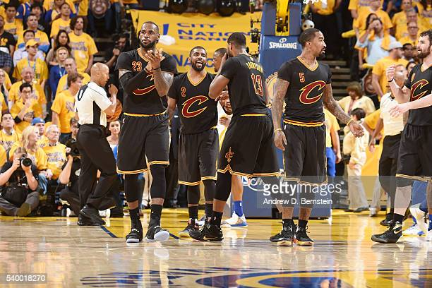 LeBron James of the Cleveland Cavaliers and Kyrie Irving of the Cleveland Cavaliers celebrate with their teammates during the game against the Golden...