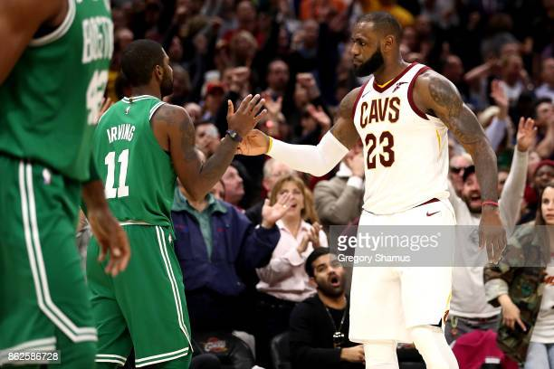 LeBron James of the Cleveland Cavaliers and Kyrie Irving of the Boston Celtics shake hands after a Cavaliers 10299 victory at Quicken Loans Arena on...