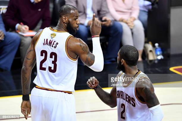 LeBron James of the Cleveland Cavaliers and Kyrie Irving react in the first quarter against the Golden State Warriors in Game 4 of the 2017 NBA...