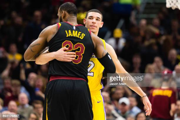 LeBron James of the Cleveland Cavaliers and Lonzo Ball of the Los Angeles Lakers embrace during the first half at Quicken Loans Arena on December 14...