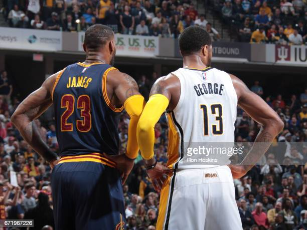 LeBron James of the Cleveland Cavaliers and Paul George of the Indiana Pacers look on during Game Four of the Eastern Conference Quarterfinals of the...