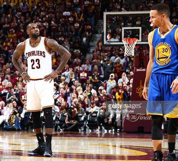 LeBron James of the Cleveland Cavaliers and Stephen Curry of the Golden State Warriors looks on during the game during the 2016 NBA Finals Game Three...
